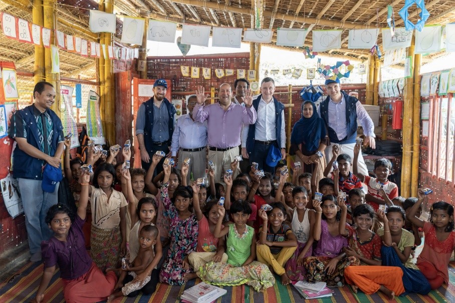 The President of the Executive Board, H.E. Hisham Mohamed Badr, and other Board members visiting camps in Cox's Bazar and witnessing the ongoing e-voucher projects.