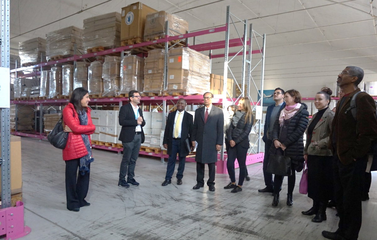 Admiring the well-organized UNHRD warehouse.