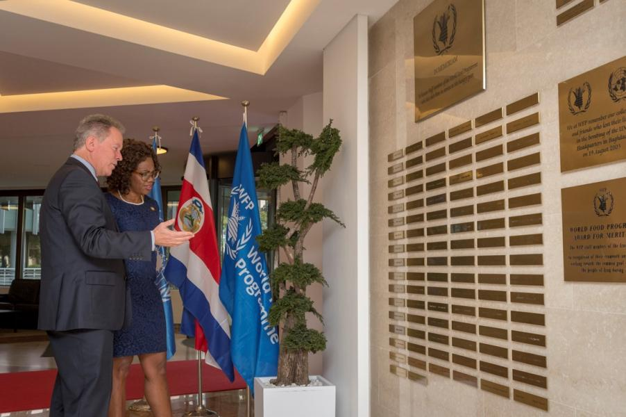 Her Excellency Epsy Campbell Barr, Vice-President of the Republic of Costa Rica, and the Executive Director stops by the Memorial Wall for a moment of reflection. A stop at the Memorial Wall is the first feature PGB includes in high-level visit scenario. Photo Credit: WFP/Giulio dAdamo