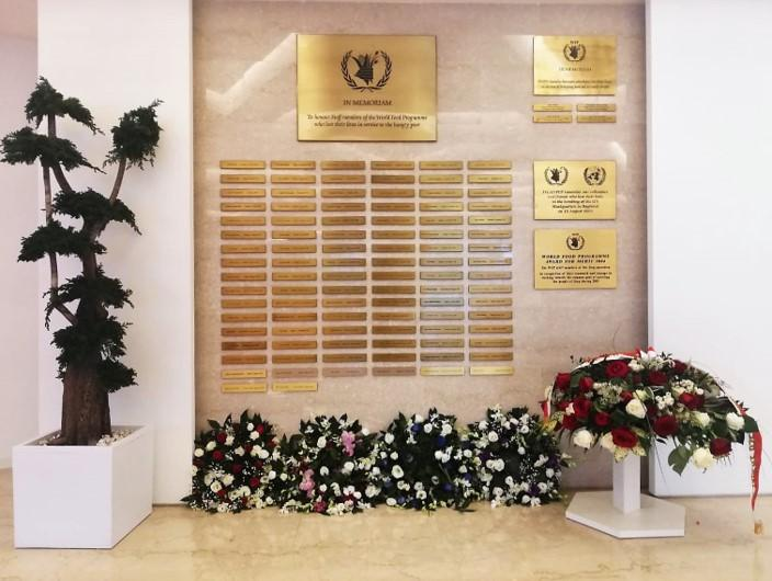 All high-level guests, stopped at the WFP Memorial Wall and laid a floral wreath comprising of the national flowers and/or colours of the national flag. Photo Credit: WFP/Luisa Ponzi