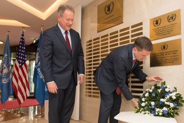 Mr Mark Green, Administrator of USAID, lays a wreath at the WFP Memorial Wall. Photo Credit: WFP/Rein Skullerud