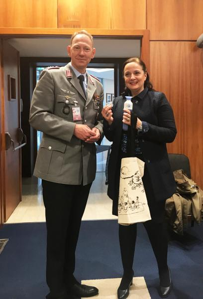 Colonel Henning Weeke, leader of the National General/Admiral Staff Officer Course at the Academy, receiving WFP visibility items, including a WFP water dopper piloted by the Executive Board Secretariat as part of the Greening the EB Initiative. Photo: WFP/Rina Manzo